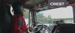 CREST logo on a photo of a firetruck driver