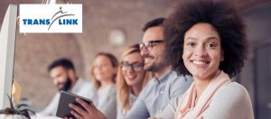 Translink Logo on photo of office workers